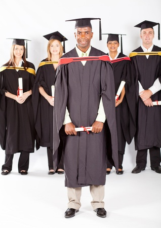 african male graduate with classmates at graduation photo