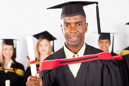 male african graduate at university graduation with classmates Stock Photo - 13058742