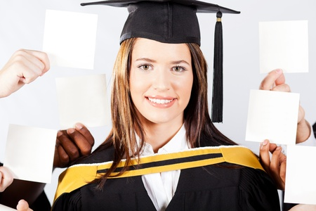 sign university: attractive female university graduate with blank notes held around her head