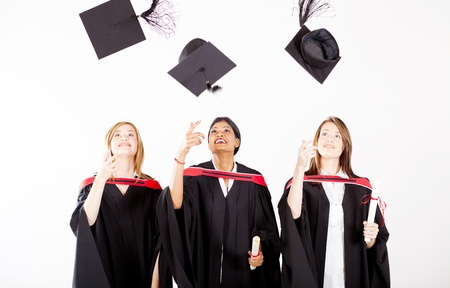 group of female graduates throwing graduation cap photo