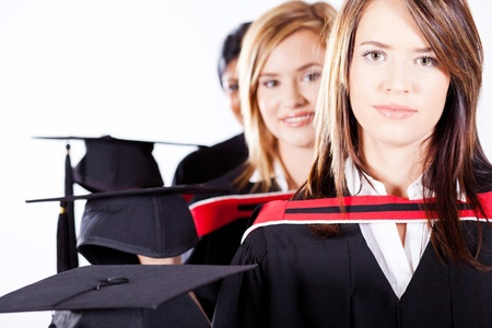 group of female graduates holding graduation caps photo