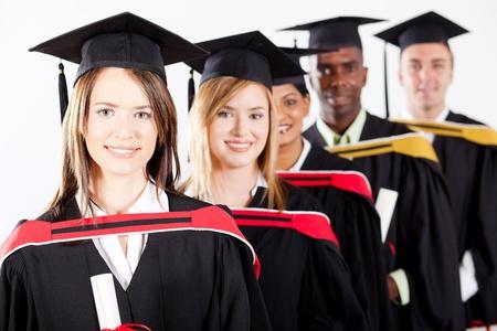 graduates: group of multiracial graduates at graduation