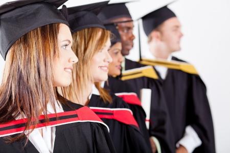 group of graduates looking away at graduation photo