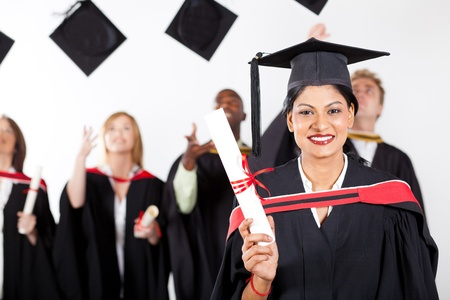 toss: happy female indian graduate at graduation with classmates throwing caps