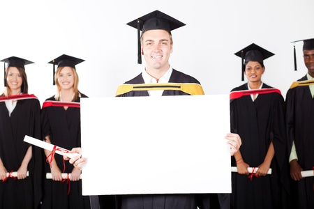 happy male graduate holding white board photo
