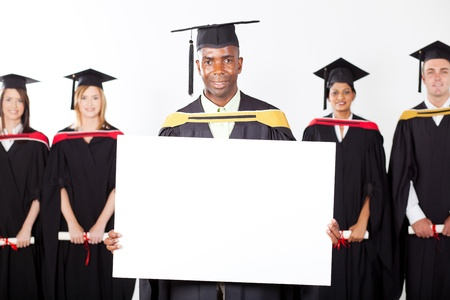 male african graduate with white board photo