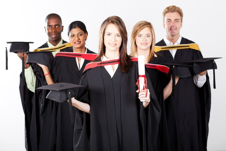 group of multiracial graduates at graduation holding caps photo