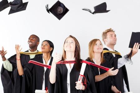 graduates throwing caps at graduation photo