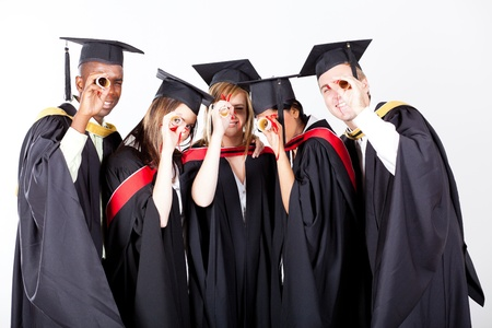 group of graduates looking through their diploma photo