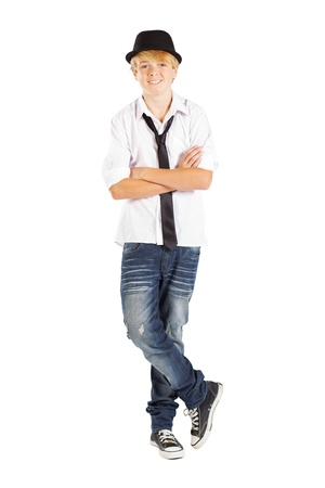 teen boy standing legs crossed on white background Stock Photo - 13102855