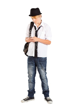 teen boy play with cell phone isolated on white photo
