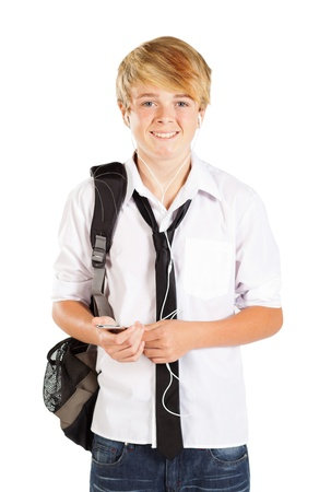 teen boy using cell phone to listen to music Stock Photo - 13103650