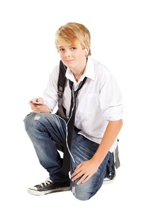 teenager boy with cell phone or mp3 player Stock Photo - 13103660