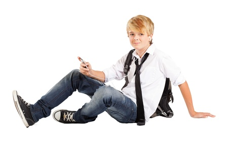 teen boy student sitting on floor isolated on white Stock Photo - 13103532
