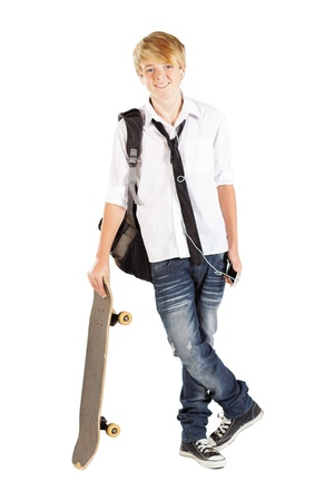 teen boy with skateboard isolated on white photo