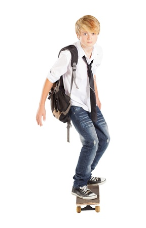 teen boy on skateboard isolated on white photo