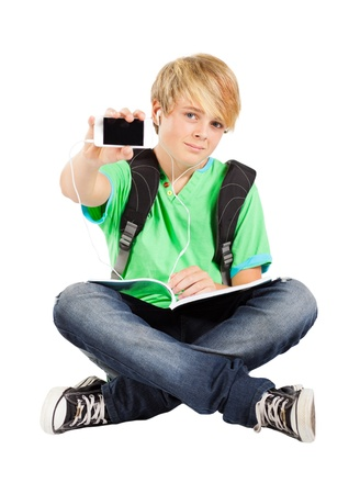 teen boy with smart phone isolated on white  photo