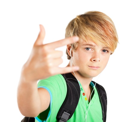 funky teen boy giving hand sign photo