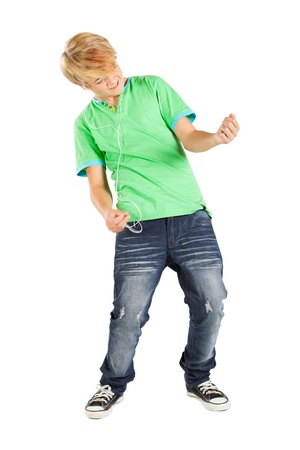 teen boy playing air guitar isolated on white photo
