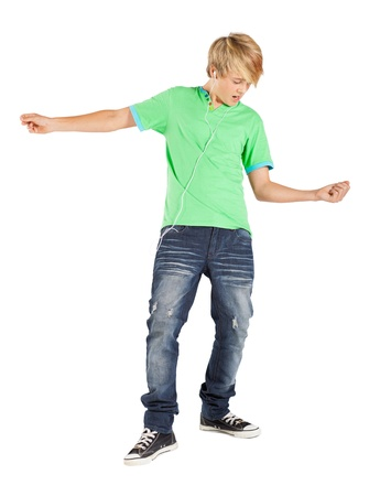 teenage boy playing air guitar isolated on white photo