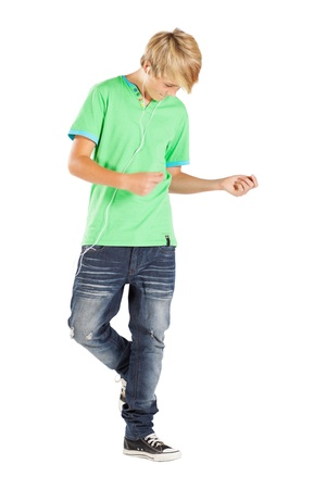 teen boy dancing with music isolated on white photo