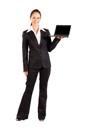 business woman standing: businesswoman presenting laptop on white