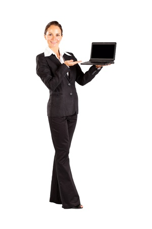 laptop stand: young woman holding a laptop isolated on white