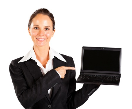 businesswoman pointing at laptop screeen photo
