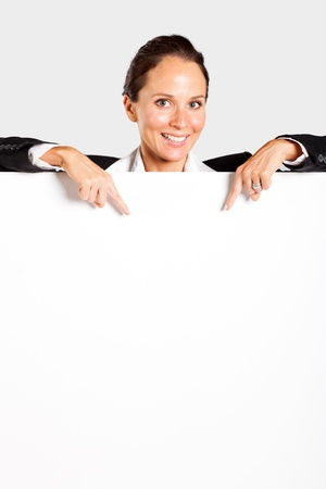 businesswoman pointing at white board photo