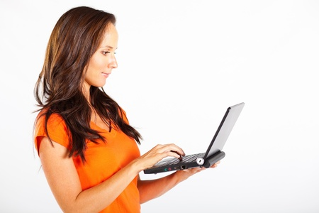 casual woman using laptop computer photo