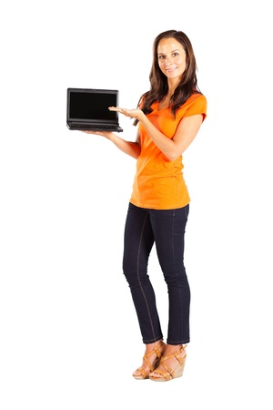 casual woman presenting laptop photo