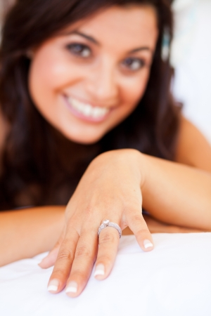 girl with rings: happy bride showing her wedding ring