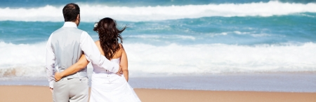 groom and bride on beach photo