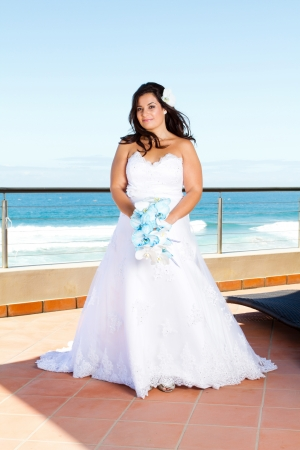 pretty young bride with bouquet photo