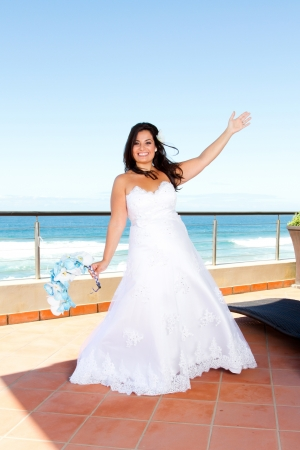 cheerful young bride on balcony photo