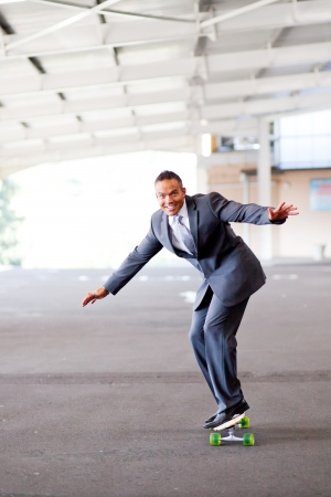 happy young businessman on skateboard photo