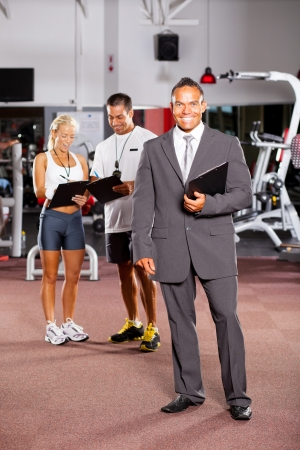 happy gym manager and trainers inside gym Stock Photo - 13738413
