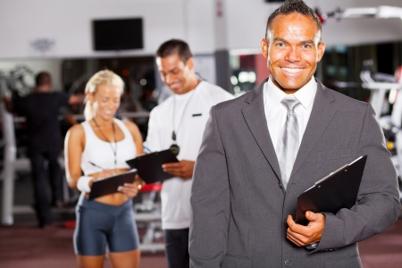 happy gym manager and trainers Stock Photo - 13738679