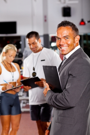 health club: health club manager and trainers