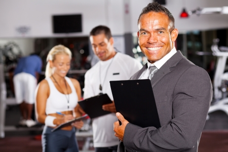 confident gym manager and staff Stock Photo - 13738523