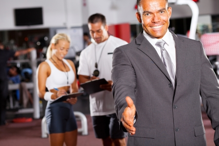 friendly gym manager hand shake gesture Stock Photo - 13738858