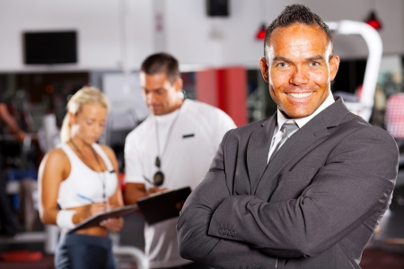 confident male gym manager portrait  photo