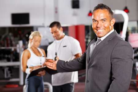 friendly gym manager welcome customer photo