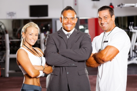 happy group gym manager and trainers photo