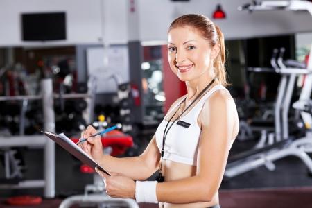 half  length: female gym instructor half length portrait