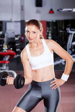 young fitness woman exercise with dumbbell Stock Photo - 13738362