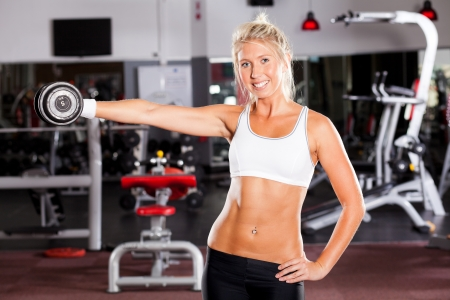 fitness woman exercising with dumbbell in gym Stock Photo - 13738467