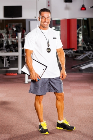 professional male gym trainer portrait photo