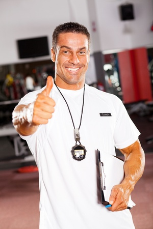 trainer: professional male school sports coach giving thumb up Stock Photo