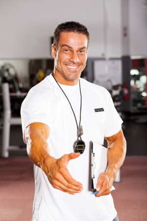 friendly male personal trainer hand shake photo